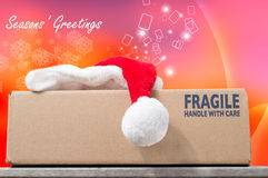 Season's Greetings with a Christmas purchase in a brown box on a Royalty Free Stock Photo