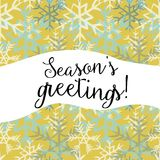 Season`s greetings. Vector illustration of white and blue snowflakes on yellow background. Season`s greetings. Hand drawn white and blue snowflakes on yellow vector illustration
