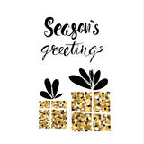 Season's greetings/ handwritten  Christmas calligraphy. Two Gifts from golden glitter isolated on white. Stock Photo