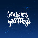 Season`s greetings -lettering Christmas and New Year holiday calligraphy phrase isolated on the shining background  Stock Photos
