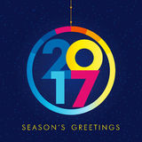 2017 season's greetings. Happy holidays winter blue colored background, snowball shape. 2017 greetings, digits, emblem 12th, 17th, 27th, 21st bright graphic Stock Image