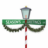 Season's Greetings Street Sign 3. Season's Greetings Street Sign with lantern and Pine Garland with Berries on white Stock Images