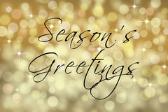 Seasons Greetings text card with bokeh background. Stock Images