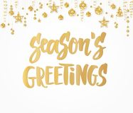 Season`s greetings card. Hand drawn lettering. Golden glitter border with hanging balls. Great for Christmas gift tags. Season`s greetings text, hand drawn Stock Photography