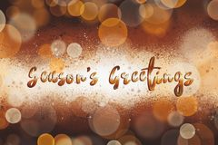 Season`s greetings text, handwritten golden sign at christmas sh vector illustration