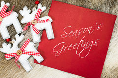 Seasons Greetings text written on red card Royalty Free Stock Photo