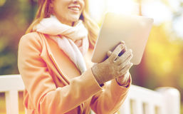 Close up of woman with tablet pc in autumn park Royalty Free Stock Photos
