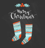 Season vector holiday  design with calligraphy - Merry Christmas. Hand-written Christmas lettering and christmas socks for gifts. Hand-written Christmas Royalty Free Stock Photo