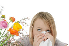 Seasonal allergy. Woman with tissue and flowers Stock Photos