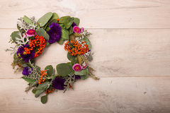 Seasonal autumn wreath. With flowers and berries stock photos