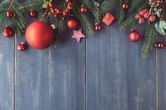 Seasonal background with decorated Christmas tree twigs on dark. Wood. Mockup, postcard or website header design with copyspace Royalty Free Stock Photo