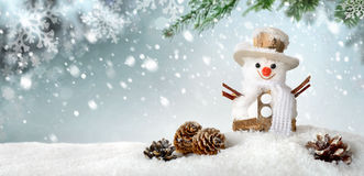 Seasonal background with happy snowman. Modern seasonal background in blue-green and white, with a cute happy snowman in the snow, ideal for Christmas or winter royalty free stock photography