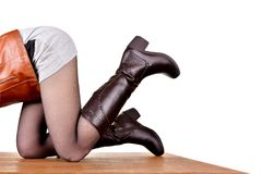 Seasonal boots on the legs of a girl. Isolated white background stock photo