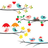 Seasonal branches and birds Stock Images