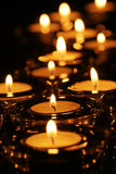 Seasonal candle light. With shallow depth of field Royalty Free Stock Photos