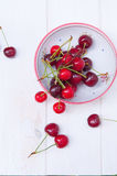 Seasonal cherries in bowl Royalty Free Stock Photo