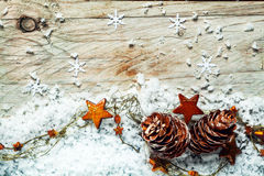 Seasonal Christmas background with cones and stars stock photography