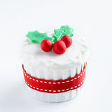 Seasonal christmas cupcake. Christmas cupcake in traditional red green colours with mistletoe, decorative element stock photos