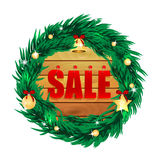 Seasonal christmas sale. Word sale on wooden boards in the frame of the christmas decorations.seasonal christmas sale Stock Image