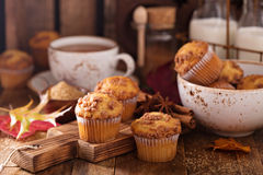 Seasonal cinnamon streusel muffins. With tea in a rustic setting Stock Photos