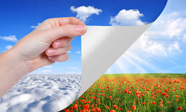 Seasonal concept. Hand turns a sheet of paper. Seasonal concept royalty free stock images