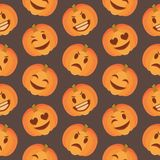 Seasonal cute Halloween seamless pattern with happy and sad carved pumpkin faces on  black background royalty free illustration