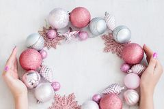 Seasonal decor christmas background hands wreath. Seasonal decor. festive christmas background. woman hands embracing wreath made of decorative toys balls and royalty free stock photos