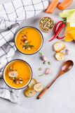Seasonal fall autumn roasted  pumpkin carrot soup with ingredients Royalty Free Stock Photo