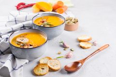 Seasonal fall autumn roasted orange pumpkin carrot soup with ingredients Stock Photography