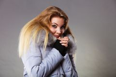 Woman wearing winter warm furry jacket Royalty Free Stock Photography