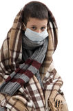Seasonal flu epidemic. Boy ill flu. Sick sad little boy wrapped in a blanket. Seasonal flu epidemic Stock Photos