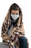 Seasonal flu epidemic. Boy ill flu. Sick sad little boy wrapped in a blanket. Seasonal flu epidemic Stock Image