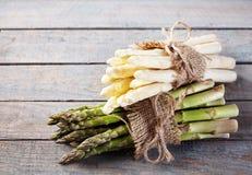 Seasonal fresh green and white spring asparagus Royalty Free Stock Photo