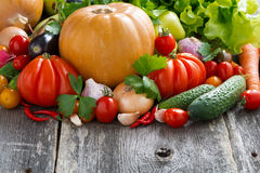 Seasonal fresh vegetables on wooden background Stock Photo