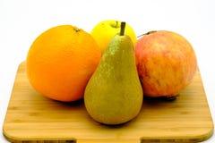 Seasonal fruit of Spain, pomegrenate, pear, apple and orange. Isolated royalty free stock photography