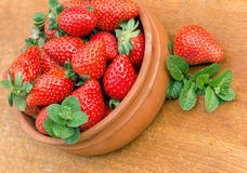 Seasonal fruit - strawberries  in rustic bowl Stock Photos