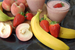 Seasonal fruits. Smoothie with fresh fruit in season Stock Photography