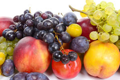 Seasonal fruits, grapes, plums, pears Stock Images