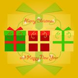 Colorful christmas gifts stacked next to each other with merry christmas and happy new year greetings on yellow background Royalty Free Stock Image