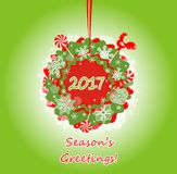 Seasonal greetings with hanging wreath Royalty Free Stock Photography