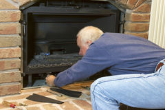 Seasonal Maintenance on Gas Fireplace Stock Photos