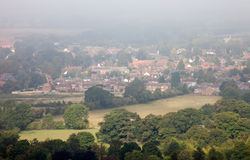 Seasonal morning mists over an English town. Morning mists over the town of Watlington in Oxfordshire, England, in early autumn Stock Photos