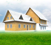 Seasonal mountain cottage with green grass and blue sky Royalty Free Stock Images