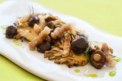 Seasonal mushrooms grilled with pork strips. Royalty Free Stock Photos