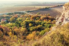 Seasonal natural outdoors scene, vivid filter. Seasonal natural outdoors scene – rocks, colorful trees, village, road and fields. Beauty in nature stock photo