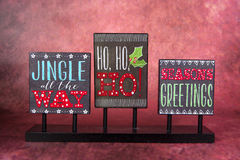 Seasonal Phrases. A sign with seasonal phrases for the Christmas holiday Royalty Free Stock Images