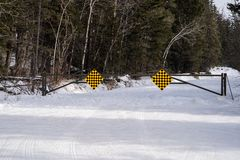 A seasonal road closure gate in Banff National Park Canada along the Bow Valley Parkway prevents tourists from venturing on a