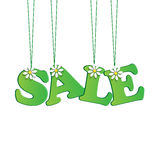 Seasonal sale. Green tag with flowers Stock Photos