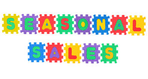 Seasonal sales. Message seasonal sales, from letter puzzle, isolated on white background Royalty Free Stock Photo