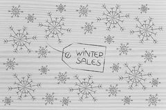 Winter Sale price tag surrounded by snowflakes Royalty Free Stock Photo